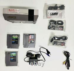 Nintendo Entertainment System Konsole+ 2 Controller+ 3 Spiele+ NES Four Score